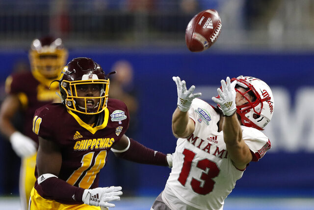 d FILE- In this Dec. 7, 2019, file photo, Miami of Ohio wide receiver Jack Sorenson (13) attempts to catch a pass as Central Michigan defensive lineman LaQuan Johnson (11) defends during the first half of the Mid-American Conference championship NCAA college football game in Detroit. The Mid-American Conference announced Friday, Sept. 25, 2020, that it will have a 6-game football season, meaning all 10 major conferences will play this fall.  (AP Photo/Carlos Osorio, File)