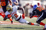North running back Joshua Kelley of UCLA (2) dives for extra yardage as South defensive back Reggie Robinson II of Tulsa (22) defends during the first half of the Senior Bowl college football game Saturday, Jan. 25, 2020, in Mobile, Ala. (AP Photo/Butch Dill)