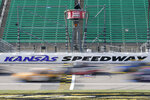 Drivers take the green flag during a NASCAR Truck Series auto race at Kansas Speedway in Kansas City, Kan., Saturday, Oct. 17, 2020. (AP Photo/Orlin Wagner)