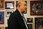 Bob Hope stands in the basement where his collection of sports memorabilia has been displayed for sale, Friday, Aug. 23, 2019, in Stone Mountain, Ga. Hope decided to part with the majority of his collection about two years after his wife Susan died. The two were sports fans who collected items together. (AP Photo/Andrea Smith)