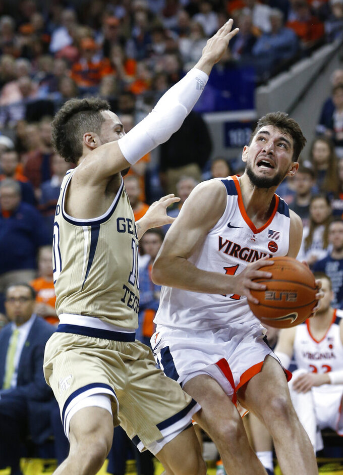 Virginia guard Ty Jerome (11) looks to shoot as Georgia Tech guard Jose Alvarado (10) defends during the second half of an NCAA college basketball game in Charlottesville, Va., Wednesday, Feb. 27, 2019. Virginia won 81-51. (AP Photo/Steve Helber)
