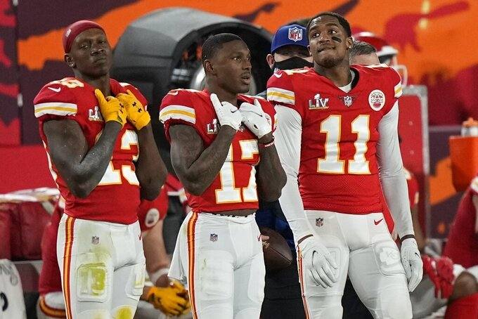 From left, Kansas City Chiefs' Byron Pringle, Mecole Hardman and Demarcus Robinson stand on the sidelines during the second half of the NFL Super Bowl 55 football game against the Tampa Bay Buccaneers, Sunday, Feb. 7, 2021, in Tampa, Fla. (AP Photo/David J. Phillip)