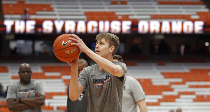 Syracuse's Marek Dolezaj shoots before an NCAA college basketball game against Boston College in Syracuse, N.Y., Saturday, Feb. 9, 2019. (AP Photo/Nick Lisi)