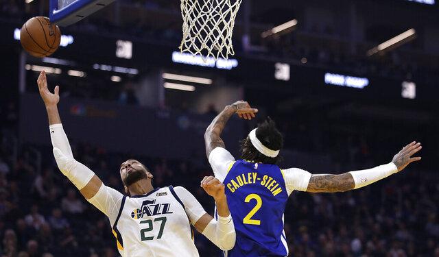 Utah Jazz center Rudy Gobert, left, reaches for a rebound past Golden State Warriors' Willie Cauley-Stein (2) in the first half of an NBA basketball game Wednesday, Jan. 22, 2020, in San Francisco. (AP Photo/Ben Margot)
