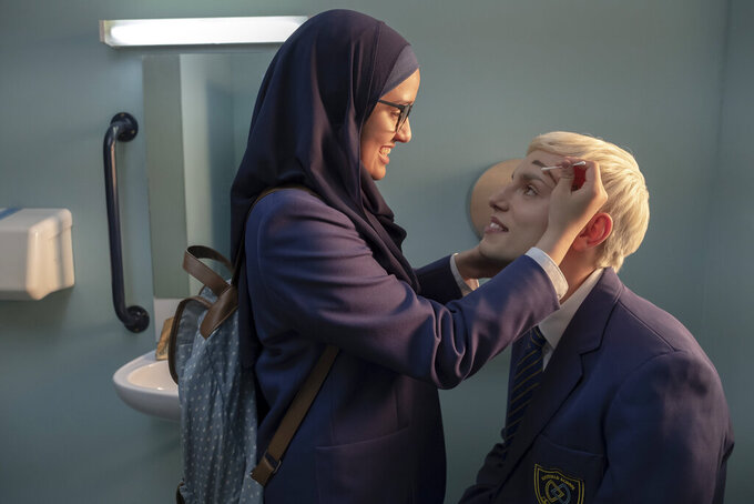 """This image released by Amazon Studios shows Lauren Patel, left, and Max Harwood in a scene from """"Everybody's Talking About Jamie."""" (Amazon Studios via AP)"""