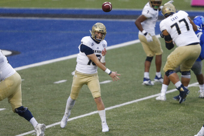 Akron quarterback Zach Gibson (15) throws a pass during the first half of an NCAA college football game against Buffalo in Amherst, N.Y., Saturday, Dec. 12, 2020. (AP Photo/Jeffrey T. Barnes)