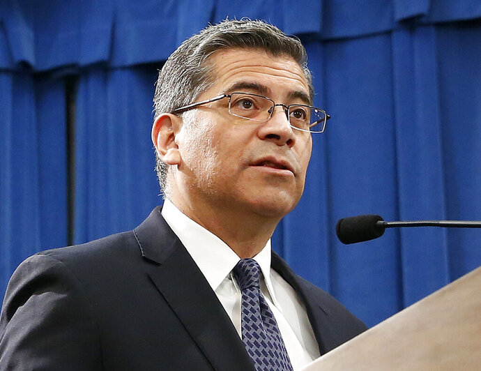 FILE - In this Feb. 15, 2019, file photo, California Attorney General Xavier Becerra speaks at a news conference in Sacramento, Calif. The U.S. Department of Education is attempting to take pandemic relief funds away from K-12 public schools and divert the money to private schools, California and four other states argued in a lawsuit filed Tuesday, July 7, 2020, against the Trump administration. Becerra and Michigan Attorney General Dana Nessel announced the lawsuit, which was joined by Maine, New Mexico, Wisconsin, and the District of Columbia. (AP Photo/Rich Pedroncelli, File)
