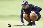 Mina Harigae lines up a putt on the 16th hole during the second round the LPGA Marathon Classic golf tournament Friday, July 9, 2021, at Highland Meadows in Sylvania, Ohio. (Jeremy Wadsworth/The Blade via AP)