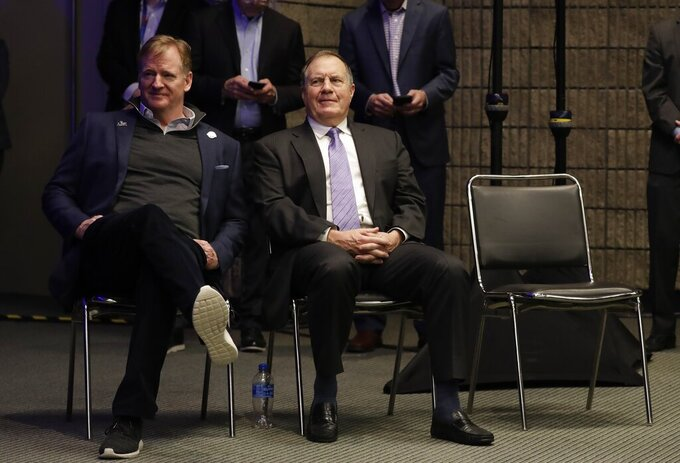 New England Patriots head coach Bill Belichick waits with NFL Commissioner Roger Goodell at a news conference for the NFL Super Bowl 53 football game Monday, Feb. 4, 2019, in Atlanta. The Patriots beat the Los Angeles Rams 13-3. (AP Photo/Morry Gash)