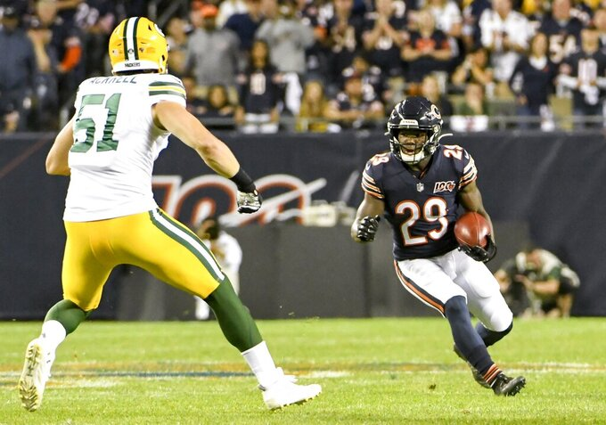 Chicago Bears' Tarik Cohen runs against Green Bay Packers' Kyler Fackrell during the first half of an NFL football game Thursday, Sept. 5, 2019, in Chicago. (AP Photo/David Banks)