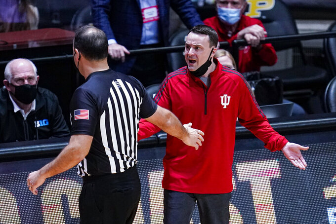 Indiana head coach Archie Miller complains to official Bo Boroski after receiving a technical foul during the second half of an NCAA college basketball game against Purdue in West Lafayette, Ind., Saturday, March 6, 2021. (AP Photo/Michael Conroy)