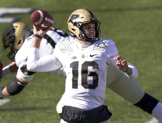 FILE - In this Oct. 31, 2020, file photo, Purdue quarterback Aidan O'Connell passes during the first half of an NCAA college football game against Illinois in Champaign, Ill. O'Connell is trying to defend his title as the opening day starter. (AP Photo/Charles Rex Arbogast, File)