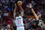 Miami Heat guard Dion Waiters (11) shoots as Los Angeles Clippers guard Landry Shamet (20) defends during the first half of an NBA basketball game, Friday, Jan. 24, 2020, in Miami. (AP Photo/Lynne Sladky)