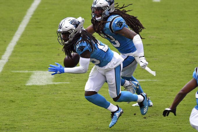 Carolina Panthers cornerback Donte Jackson (26) runs in front of teammate free safety Tre Boston (33) after intercepting a pass by Tampa Bay Buccaneers quarterback Tom Brady during the second half of an NFL football game Sunday, Sept. 20, 2020, in Tampa, Fla. (AP Photo/Jason Behnken)
