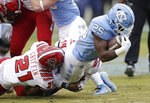 North Carolina State's Stephen Griffin (21) tackles North Carolina's Javonte Williams (25) during the first half of an NCAA college football game in Chapel Hill, N.C., Saturday, Nov. 24, 2018. (AP Photo/Gerry Broome)