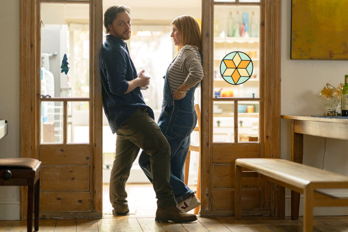 """This image released by Bleecker Street shows James McAvoy, left, and Sharon Horgan in a scene from """"Together."""" (Peter Mountain/Bleecker Street via AP)"""