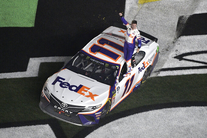 Denny Hamlin (11) celebrates after winning a NASCAR Daytona 500 auto race at Daytona International Speedway, Sunday, Feb. 17, 2019, in Daytona Beach, Fla. (AP Photo/Phelan M. Ebenhack)