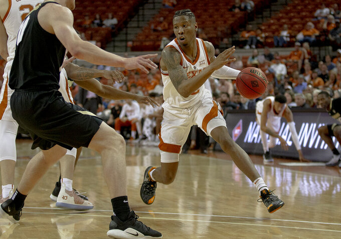 Osetkowski scores 15 to lift Texas by Colorado 68-55 in NIT