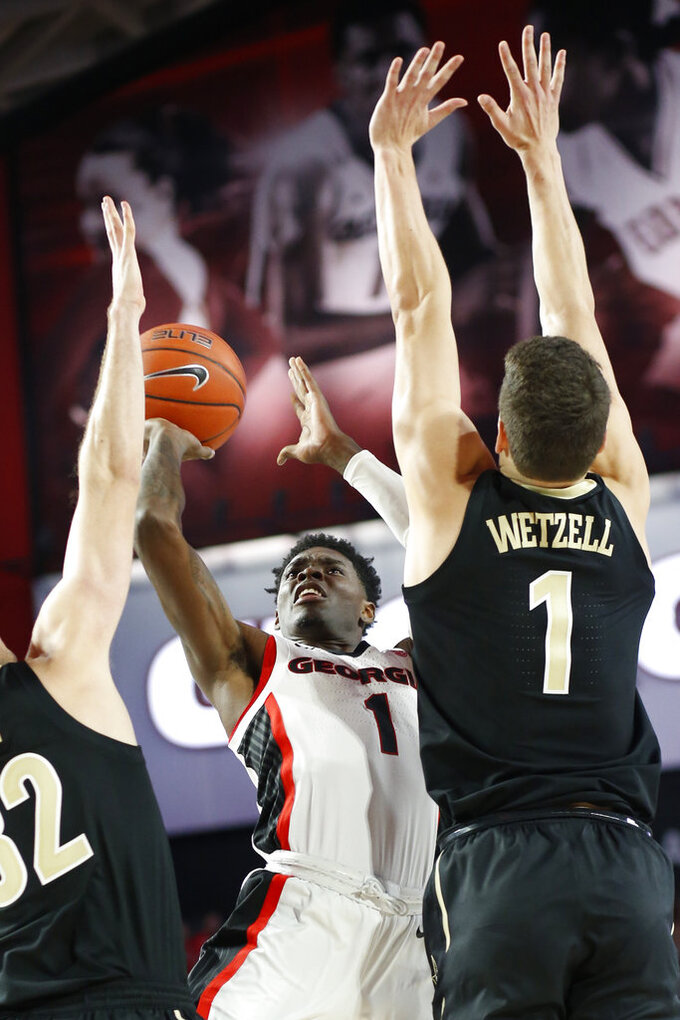 Georgia guard Teshaun Hightower (1) takes a shot over Vanderbilt forward-center Yanni Wetzell (1) during an NCAA college basketball game, Wednesday, Jan. 9, 2019 in Athens, Ga. (Joshua L. Jones/Athens Banner-Herald via AP)