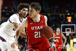 Utah forward Riley Battin (21) drives to the basket around Arizona State's Taeshon Cherry during the first half of an NCAA college basketball game Saturday, Jan. 18, 2020, in Tempe, Ariz. (AP Photo/Ralph Freso)