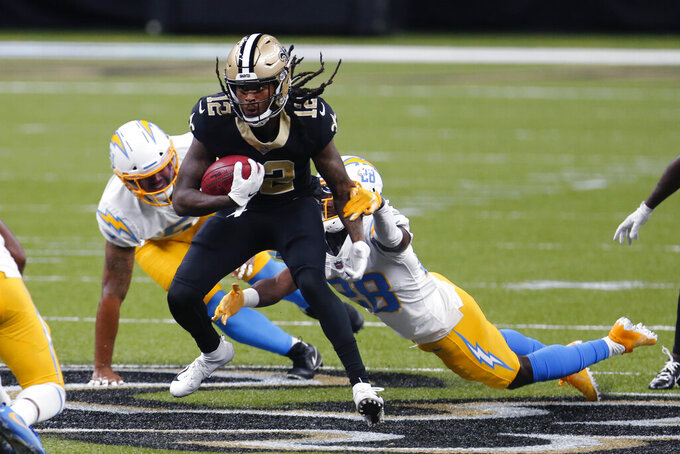 New Orleans Saints returner Marquez Callaway (12) carries against Los Angeles Chargers cornerback Brandon Facyson (28) in the first half of an NFL football game in New Orleans, Monday, Oct. 12, 2020. (AP Photo/Brett Duke)