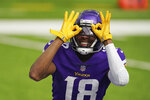 Minnesota Vikings wide receiver Justin Jefferson (18) celebrates after scoring his first NFL touchdown in the third quarter of a football game against the Tennessee Titans, Sunday, Sept. 27, 2020, in Minneapolis. (Anthony Souffle/Star Tribune via AP)