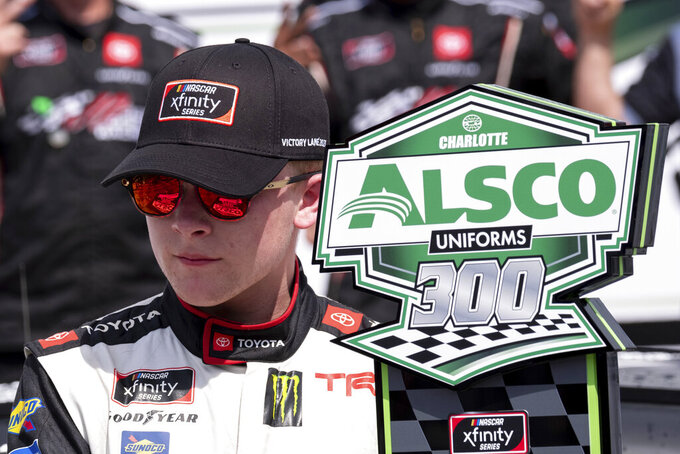 Ty Gibbs poses with the trophy after winning the Alsco Uniforms 300 NASCAR Xfinity Series auto race at Charlotte Motor Speedway on Saturday, May 29, 2021 in Charlotte, NC. (AP Photo/Ben Gray)