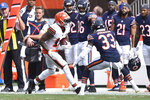 Cleveland Browns wide receiver Odell Beckham Jr. (13) runs the ball against Chicago Bears cornerback Jaylon Johnson (33) during the second half of an NFL football game, Sunday, Sept. 26, 2021, in Cleveland. (AP Photo/David Richard)