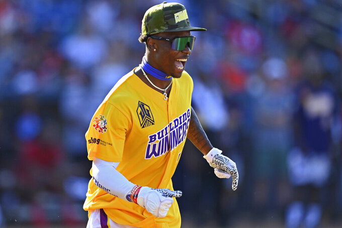 Las Vegas Raiders wide receiver Henry Ruggs III celebrates after hitting a home run during the Jarvis Landry Celebrity Softball game Saturday, June 12, 2021, in Eastlake, Ohio. (AP Photo/David Dermer)