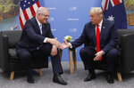 FILE - In this Nov. 30, 2018, file photo, Australian Prime Minister Scott Morrison, left, meets with U.S. President Donald Trump at the G20 in Buenos Aires, Argentina. Australia. Saturday, May 18, 2019 is the last possible date that Morrison could have realistically chosen to hold an election. (AP Photo/Pablo Martinez Monsivais, File)