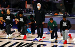 San Antonio Spurs head coach Gregg Popovich, center, and his team pause during the national anthem prior to an NBA basketball game against the Utah Jazz, Thursday, Aug. 13, 2020, in Lake Buena Vista, Fla. (Kevin C. Cox/Pool Photo via AP)