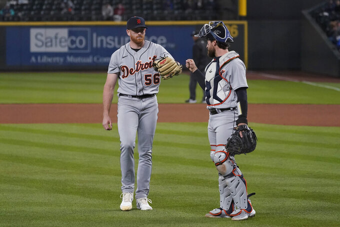 Detroit Tigers starting pitcher Spencer Turnbull, left walks with catcher Eric Haase at the end of the seventh inning of the team's baseball game against the Seattle Mariners, Tuesday, May 18, 2021, in Seattle. (AP Photo/Ted S. Warren)