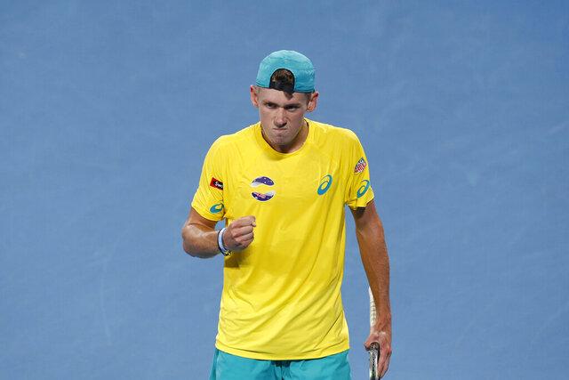 Alex de Minaur of Australia walks towards his teammates after winning a point against Rafael Nadal of Spain during their ATP Cup tennis match in Sydney, Saturday, Jan. 11, 2020. (AP Photo/Steve Christo)