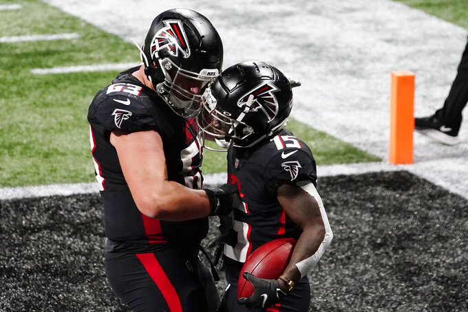 Atlanta Falcons wide receiver Brandon Powell (15) celebrates his touchdown with Chris Lindstrom during the second half of an NFL football game against the Las Vegas Raiders , Sunday, Nov. 29, 2020, in Atlanta. (AP Photo/Brynn Anderson)