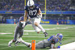 Penn State tight end Pat Freiermuth (87) leaps past Memphis defensive backs Chris Claybrooks (7) and Memphis Carlito Gonzalez (29) in the first half of the NCAA Cotton Bowl college football game, Saturday, Dec. 28, 2019, in Arlington, Texas. Freiermuth was ruled out of bounds inside the five yard line. (AP Photo/Ron Jenkins)