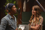 This image released by Focus Features shows Kelvin Harrison Jr., left, and Dakota Johnson in a scene from