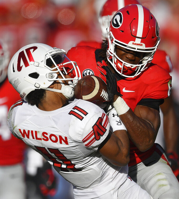Georgia running back James Cook (6) hits Austin Peay wide receiver DeAngelo Wilson (11) on a kick return during the second half of an NCAA college football game, Saturday, Sept. 1, 2018, in Athens, Ga. Cook was ejected from the game. Georgia won 45-0. (AP Photo/Mike Stewart)