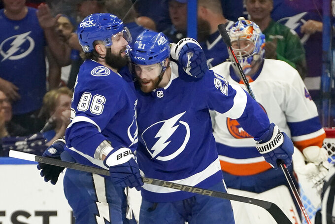 Tampa Bay Lightning center Brayden Point (21) celebrates his goal against the New York Islanders with right wing Nikita Kucherov (86) during the first period in Game 2 of an NHL hockey Stanley Cup semifinal playoff series Tuesday, June 15, 2021, in Tampa, Fla. (AP Photo/Chris O'Meara)
