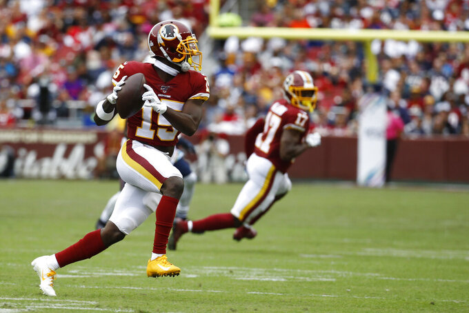 Washington Redskins wide receiver Steven Sims (15) runs against the New England Patriots during the first half of an NFL football game, Sunday, Oct. 6, 2019, in Washington. (AP Photo/Patrick Semansky)