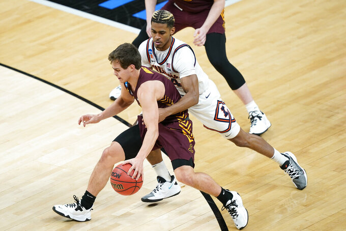 Loyola of Chicago's Braden Norris, left, is defended by Illinois' Adam Miller, right, during the first half of a college basketball game in the second round of the NCAA tournament at Bankers Life Fieldhouse in Indianapolis Sunday, March 21, 2021. (AP Photo/Mark Humphrey)