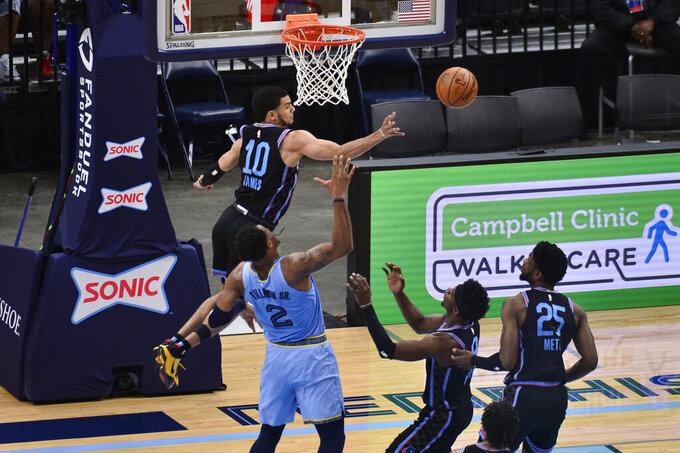 Sacramento Kings guard Justin James (10) knocks the ball away ahead of Memphis Grizzlies center Xavier Tillman (2) in the second half of an NBA basketball game Friday, May 14, 2021, in Memphis, Tenn. (AP Photo/Brandon Dill)