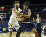 Notre Dame's Cormac Ryan (5) and Fairleigh Dickinson's Callum Baker (11) fight for the ball  during an NCAA college basketball game Tuesday, Nov. 26, 2019, in South Bend, Ind. (Michael Caterina/South Bend Tribune via AP)