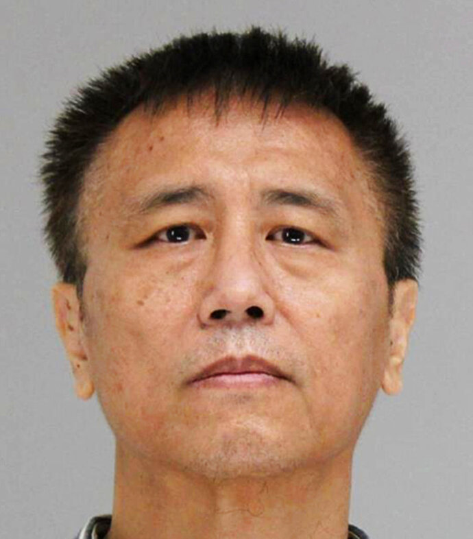 This photo provided by the Dallas County Jail shows George Guo, who is being held Thursday, June 14, 2018, on a capital murder charge. Prosecutors in Dallas say Guo, an ex-physician, has been charged in the death of a woman left incapacitated after being sexually assaulted and strangled in 1988. (Dallas County Jail via AP)