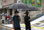 Police officers wear face masks to help protect against the spread of the coronavirus in downtown, South Korea, Wednesday, Sept. 2, 2020. (AP Photo/Lee Jin-man)