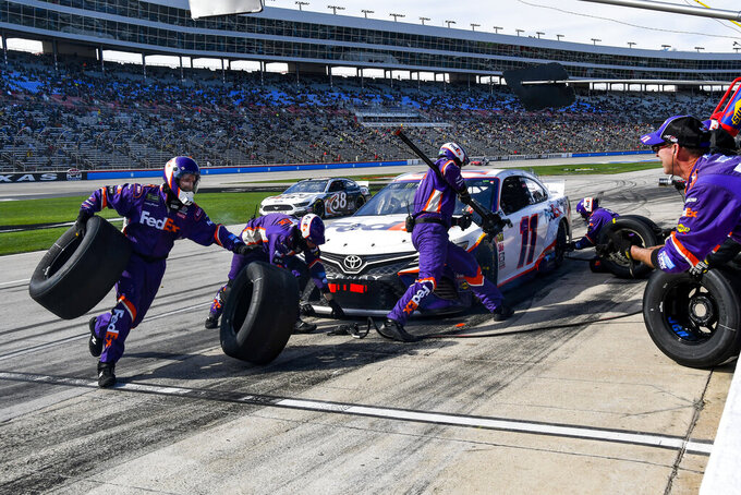 Driver Denny Hamlin's pit crew service his car during a NASCAR Cup auto race at Texas Motor Speedway, Sunday, March 31, 2019, in Fort Worth, Texas. Hamlin would win the race. (AP Photo/Larry Papke)