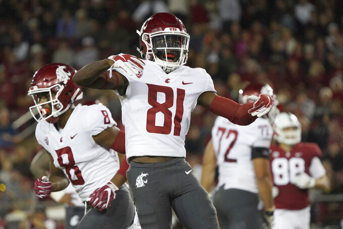 Washington State wide receiver Renard Bell celebrates a touchdown in the second half against Stanford during an NCAA college football game on Saturday, Oct. 27, 2018, in Stanford, Calif. (AP Photo/Don Feria)