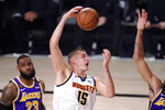 Denver Nuggets' Nikola Jokic (15) plays against the Los Angeles Lakers during the first half of an NBA conference final playoff basketball game Saturday, Sept. 26, 2020, in Lake Buena Vista, Fla. (AP Photo/Mark J. Terrill)