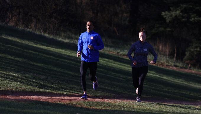Modern love: Pentathlon couple balances training, military