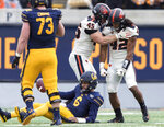 Oregon State defensive lineman Simon Sandberg (45) and teammate Doug Taumoelau (42) react after sacking California quarterback Devon Modster (6) in the second quarter of an NCAA college football game in Berkeley, Calif., Saturday, Oct. 19, 2019. (AP Photo/John Hefti)