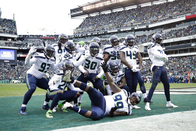 Seattle Seahawks' Bradley McDougald (30) celebrates with teammates after intercepting a Philadelphia Eagles' pass during the first half of an NFL football game, Sunday, Nov. 24, 2019, in Philadelphia. (AP Photo/Matt Rourke)